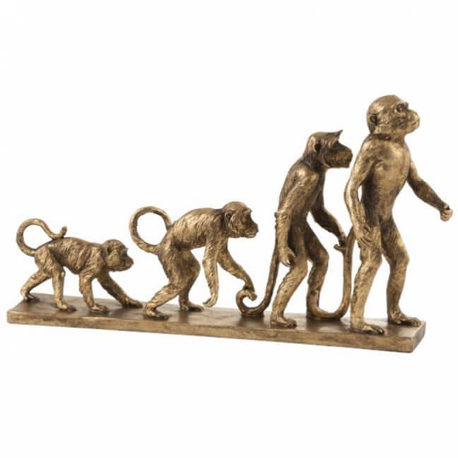 figurine sur l'évolution du singe en résine de couleur or
